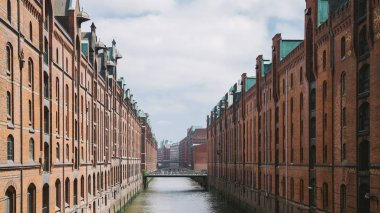 Elbe river, bridge and buildings at warehouse district in Hamburg, Germany