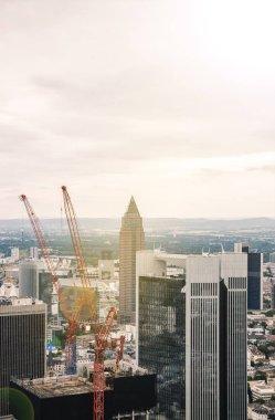 Aerial view skyscrapers and buildings near crane in Frankfurt, Germany stock vector