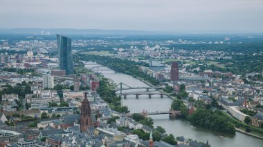 aerial view of bridges over Main river and buildings in Frankfurt, Germany