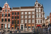 20 MAY 2018 - AMSTERDAM, NETHERLANDS: facades of old buildings on street of Amsterdam on sunny day