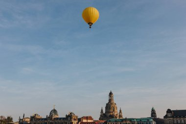 hot air balloon flying over city of Dresden, Germany