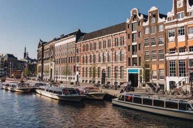 20 MAY 2018 - AMSTERDAM, NETHERLANDS: beautiful ships on canal at Amsterdam, Netherlands