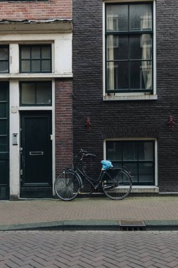 facade of old building with parked bicycle, Amsterdam, Netherlands