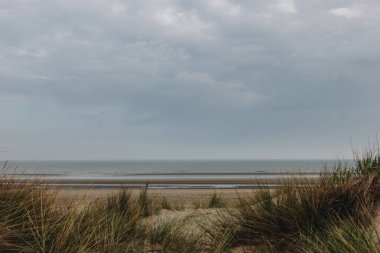 dramatic shot of sandy seashore on cloudy day, Bray Dunes, France