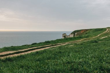 beautiful green meadow on cliff over sea at Etretat, France