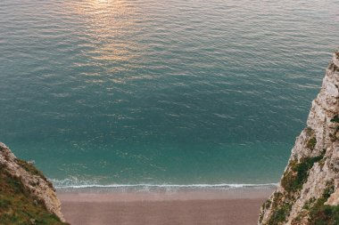 high angle view of beautiful beach between rocky cliffs at Etretat, France