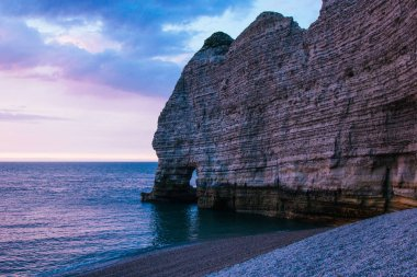 calm evening at the sea near cliff, Etretat, Normandy, France