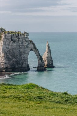 background landscape with cliffs and blue sea, Etretat, Normandy, France
