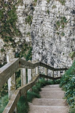 stone stairs with wooden railing on cliff, Etretat, Normandy, France