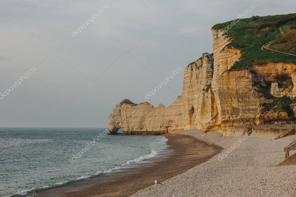 scenic shot of dramatic seashore on cloudy day at Etretat, France