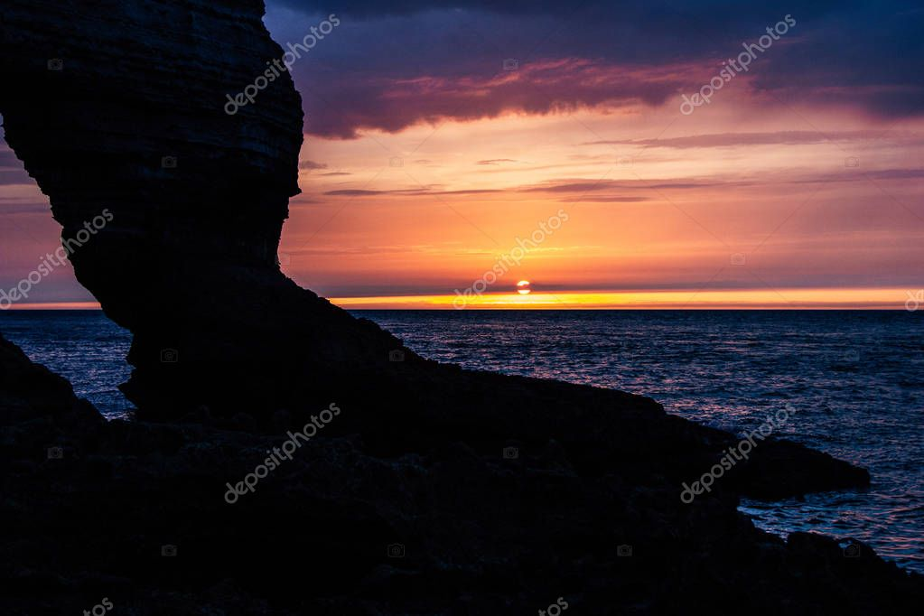 tranquil shot of rocky cliff on cloudy sunset, Etretat, France