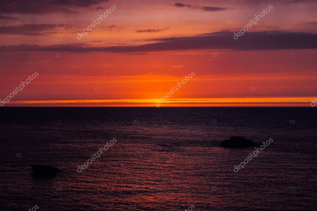 background with red sunset over the sea, Etretat, Normandy, France