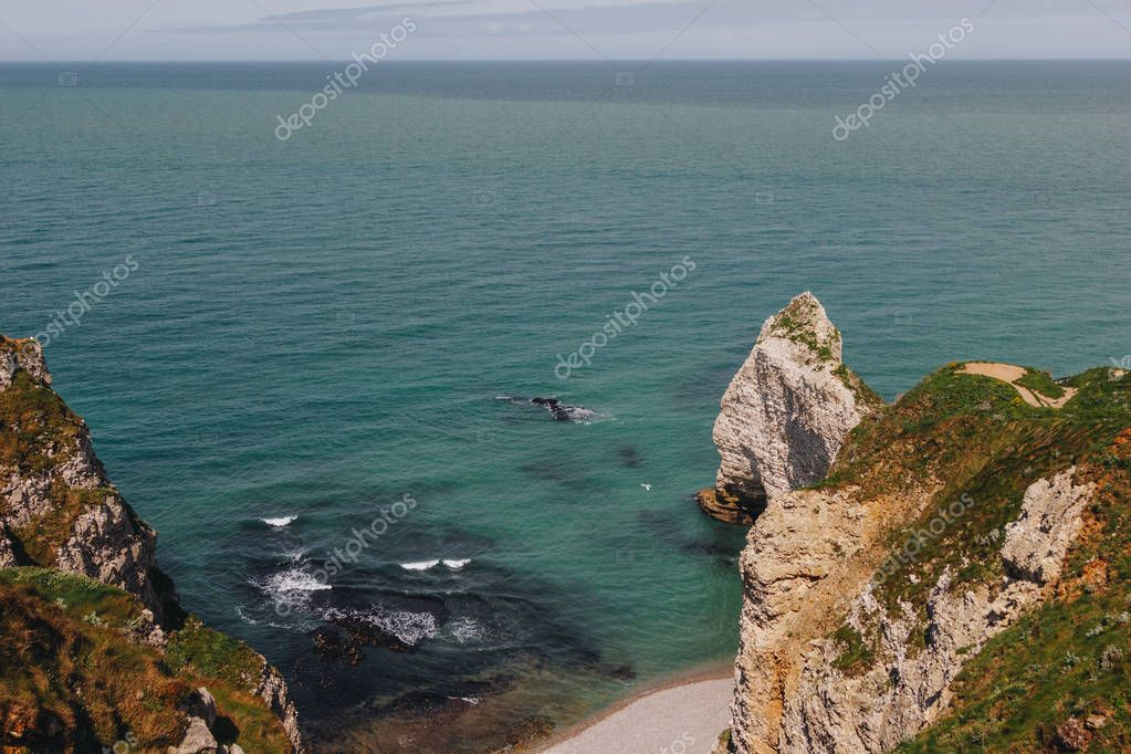calm view from cliff on beautiful blue sea, Etretat, Normandy, France