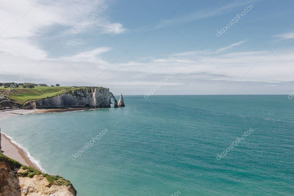 calm landscape with cliff and blue sea, Etretat, Normandy, France