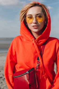 attractive girl in red hoodie on beach, saint michaels mount, France