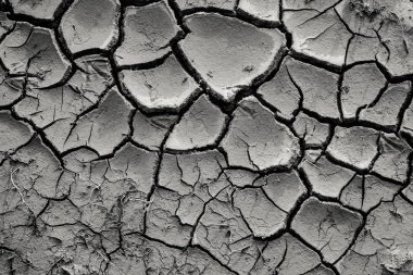 top view of cracked black dry ground, natural background