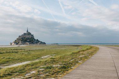 beautiful view of famous mont saint michel and walkway at sea coast, normandy, france