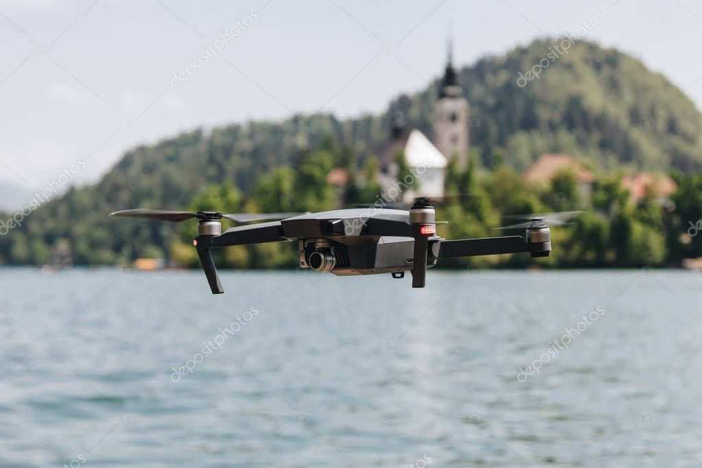 close-up view of flying drone above mountain lake, bled, slovenia