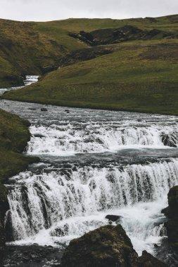Skoga river flowing through highlands in Iceland stock vector
