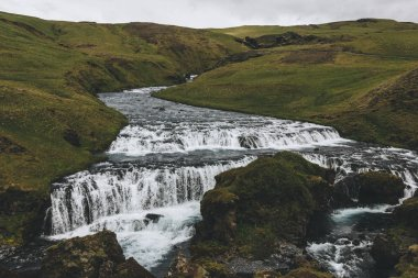 landscape with beautiful Skoga river flowing through highlands in Iceland