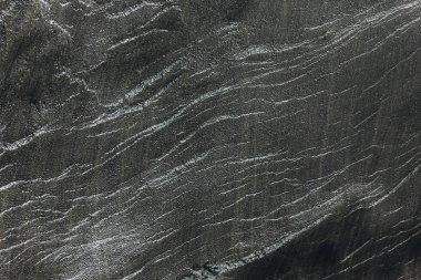 Full frame image of dark stone background in Iceland stock vector