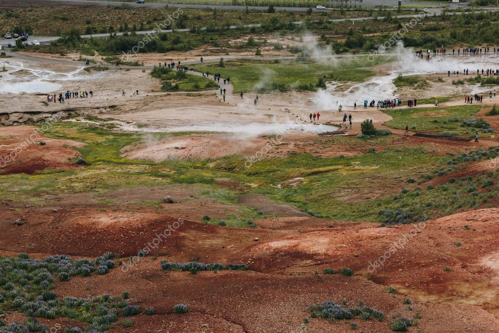 ICELAND - 20 JUNE 2018: aerial view of tourists near volcanic vents in Haukadalur valley