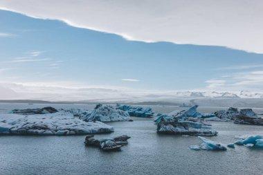 Scenic shot of glacier ice pieces floating in lake in Jokulsarlon, Iceland stock vector