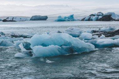 Glacier ice pieces floating in lake in Jokulsarlon, Iceland stock vector