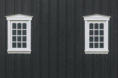 White windows on old black building facade stock vector