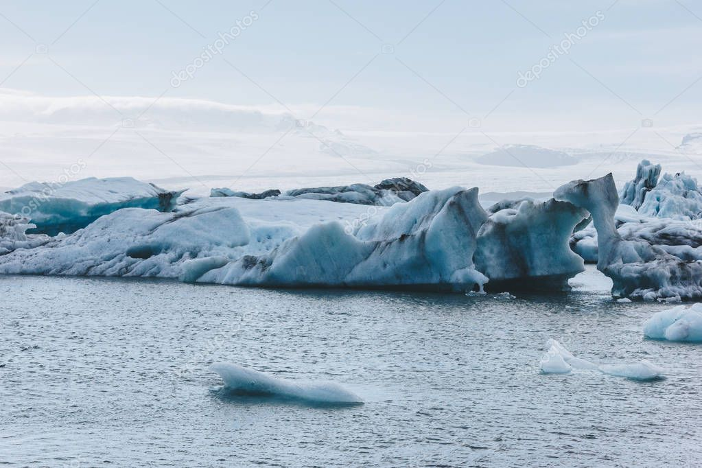 beautiful glacier ice pieces floating in lake in Iceland