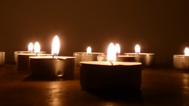 candle on a black background. black background and blowing candle
