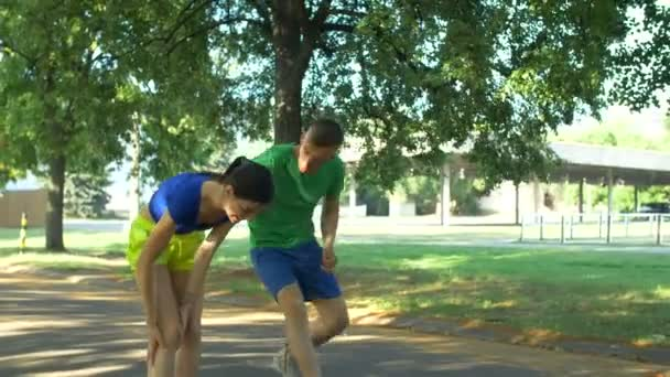 Female runner with injured ankle getting help from man