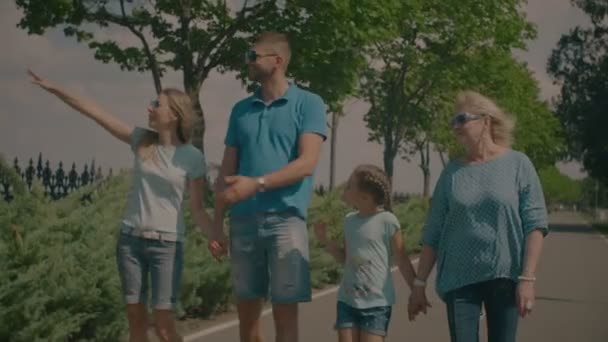 Cheerful three generation family walking outdoors