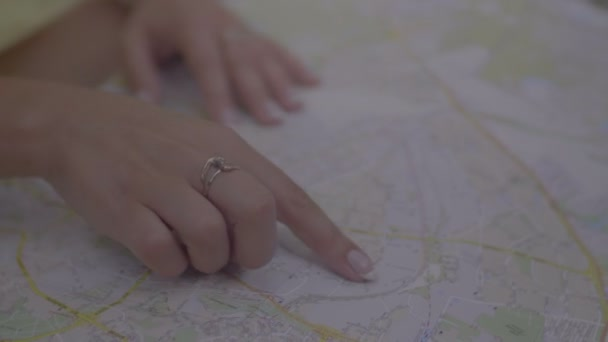 Woman with travel map planning vacation trip