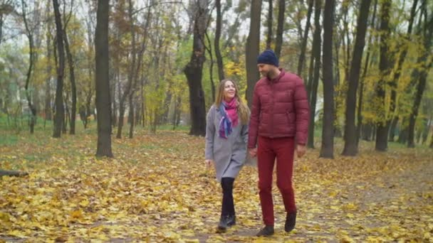 Affectionate couple on romantic date in autumn park