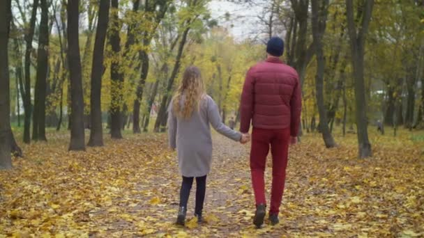 Loving couple taking a stroll in autumn nature