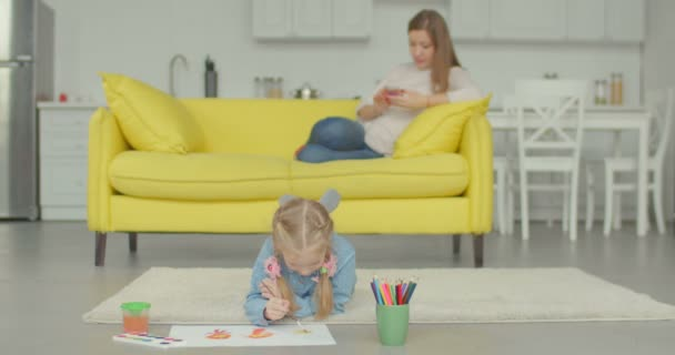 Cute little girl painting picture with watercolors