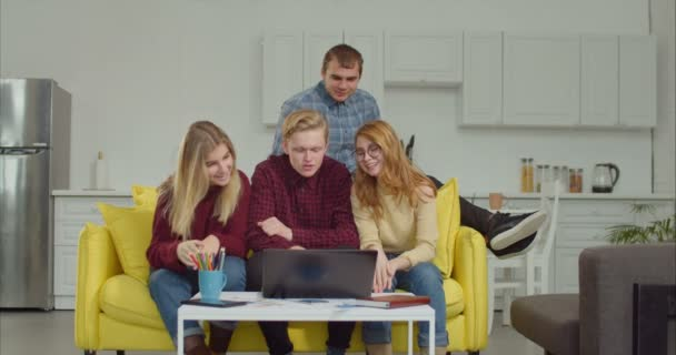 Positive friends making online video call on laptop