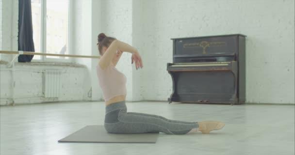 Graceful yogi woman practicing forward bend exercise