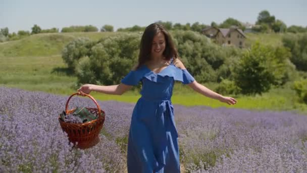 Joyful woman with arms outstretched walks in field