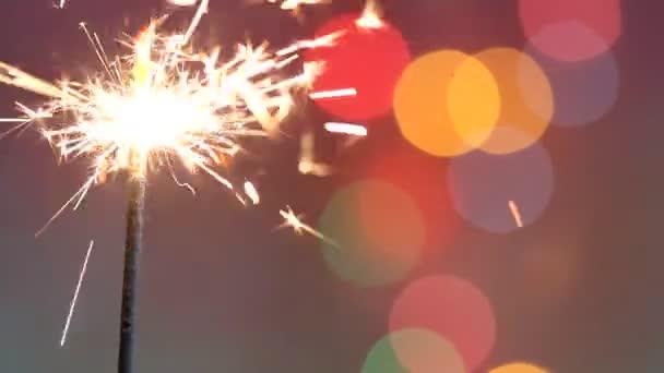Csillagszóró bottal a absztrakt színes karácsonyi újévi party birthday háttér