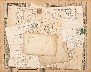 Vintage postcards. Old handwritten letter. Used paper background