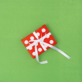 Gift box red white on green background. Voucher gift card concept