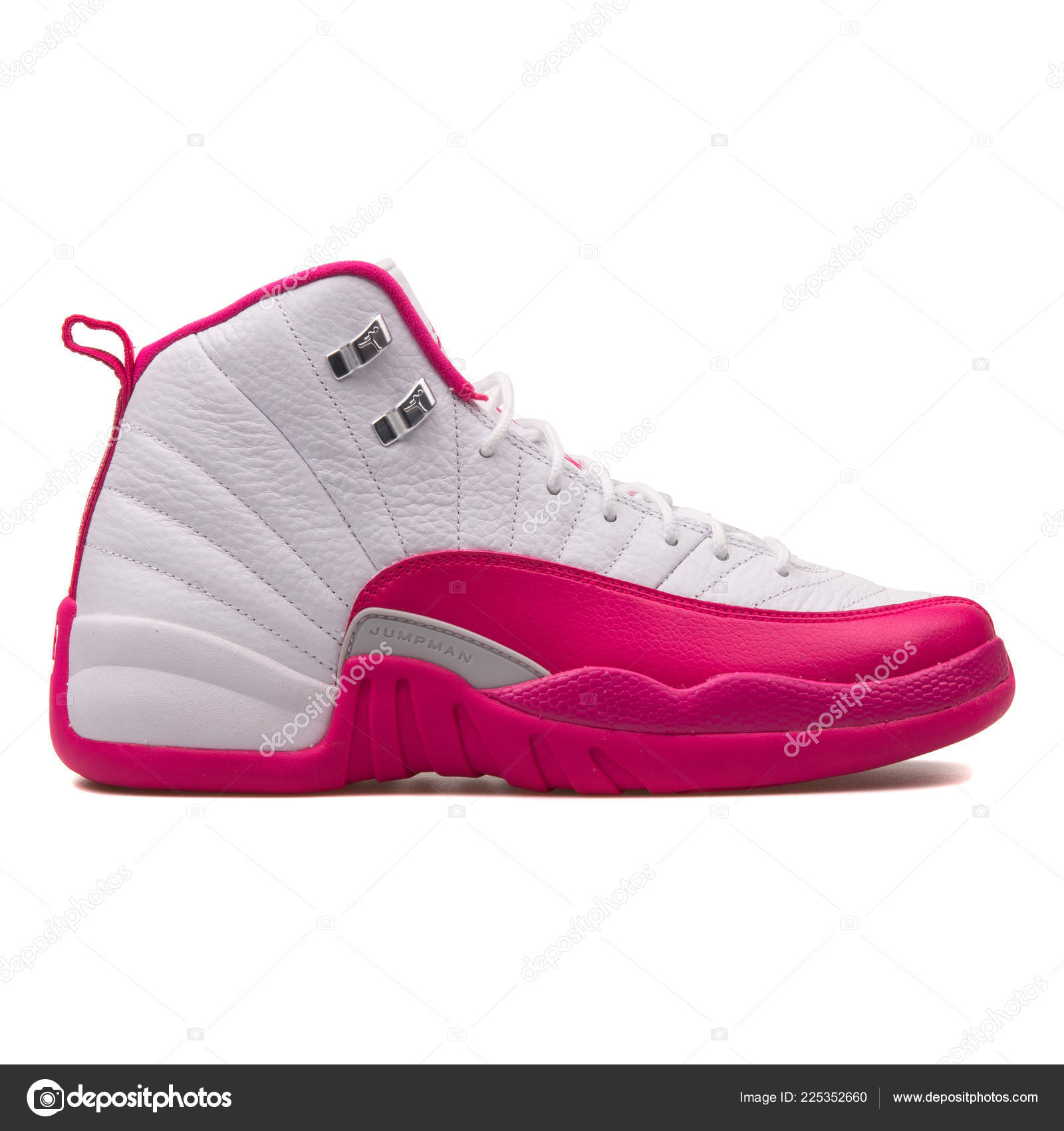 half off f78c0 c657d VIENNA, AUSTRIA - JUNE 14, 2017  Nike Air Jordan 12 Retro pink and white  sneaker isolated on white background. — Photo by xMarshallfilms