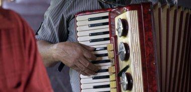 Guararema, SP, Brazil - November 4, 2017 - Closeup of Northeastern accordionist fingering the keys of his musical instrument. Sao Paulo, Brazil