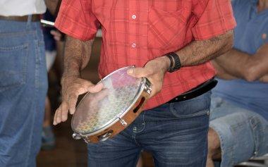 Guararema, SP, Brazil - November 4, 2017 - Closeup of popular musician playing tambourine