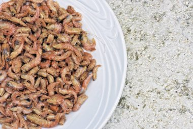 Portion of dry shrimp, ingredient of several famous dishes of Brazilian cuisine, on neutral background top view