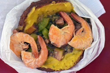 Acaraje with its traditional filling, the famous Afro Brazilian religious offering, today succeeds as street food
