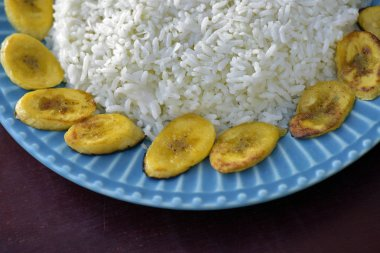 Brazilian cuisine: coconut rice with fried banana accompaniment