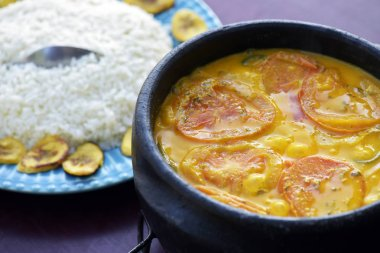 Brazilian cuisine: fish moqueca, coconut rice and fried banana